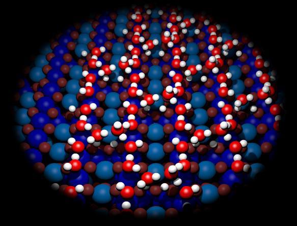 Wassermoleküle bilden komplexe Strukturen auf der Eisenoxid-Oberfläche. (Bild:  TU Wien)