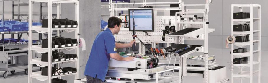 handling Thema: Montage- und Arbeitsplatzsysteme