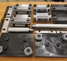 Adapterplatten, Zugstangen-Verlängerungen, Standardbacken und Grip-Backen