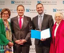 Dr. Ljuba Woppowa, Geschäftsführerin GVC; Prof. Stefan Heinrich, Chairman PARTEC 2019; Jun. Prof. Dr.-Ing. Carsten Schilde; Frau Löffler, Witwe des Preis-Namensgebers.