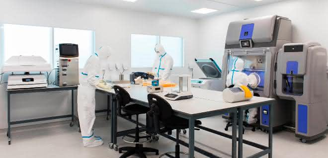 Employees in a clean room laboratory