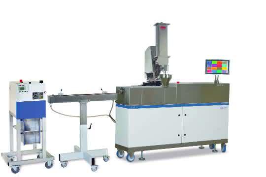 Kernstück einer Labor-Extrusionsanlage, wie sie beispielsweise  zur Produktion von Rundsträngen oder Schläuchen eingesetzt wird.