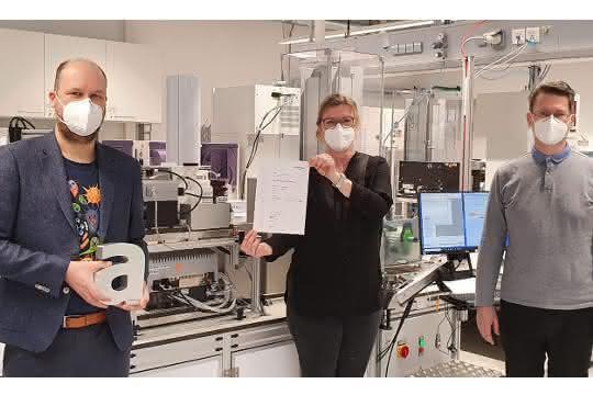 Dr. Geoffrey A. Behrens und Wissenschaftler