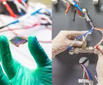 Hände halten Solarzellen und Batterien