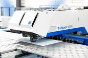 News: AMI stanzt und lasert jetzt automatisiert